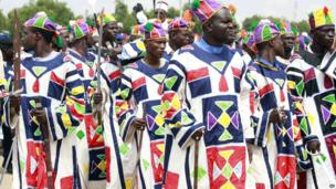 Men dress up in special outfits and carrying swords during the Eid durbar in Maiduguri, Nigeria - 8 August 2013