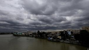 Rain clouds loom over the horizon in Manila, Philippines 13 August 2013, a day after powerful Typhoon Utor battered north-eastern Philippines that toppled power lines and dumped heavy rain across mountains, cities and food-growing plains