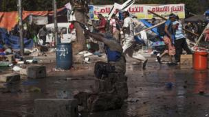 Protesters fires gun towards Egyptian police in Cairo. 15 Aug 2013
