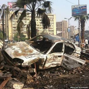 A charred car near Cairo's Rabaa al-Adawiya mosque, 15 August