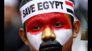 "An Indonesian, with a painted face and the words ""Save Egypt"" on his bandanna, takes part in a march in Jakarta, Egypt - Friday 16 August 2013"