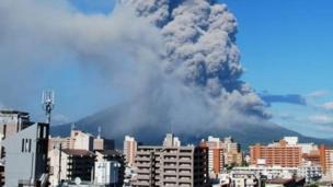 An ash cloud rises from Mount Sakurajima above Kagoshima city