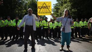 Protesters in front of police at Balcombe