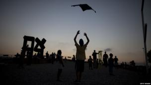 Children fly kites during the annual Kite-Flying Festival at the Israel Museum in Jerusalem.