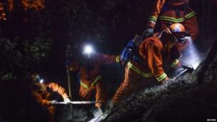 Firefighters work on steep slopes through the night, combating California's Rim Fire on 25 August 2013