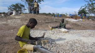 Two boys crush gold ore on a gold rush site in Shinyanga Region, Tanzania. © 2012 Juliane Kippenberg/Human Rights Watch