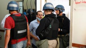 UN arms experts visit a clinic as they inspect the site of a suspected chemical weapons attack in the Ghouta, Damascus, on 28 August, 2013