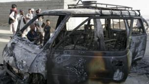 The remains of a burnt vehicle after a suicide attack in Ghazni Province, Afghanistan