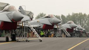 Royal Air Force Typhoon jets are stationed outside temporary hangars at RAF Northolt airbase on May 2012