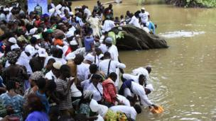 Worshippers pray at the Osun river in Nigeria on 23 August 2013