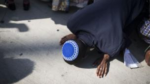 An Jewish immigrant from Ethiopia kisses the ground at Ben Gurion airport near Tel Aviv, Israel, on 28 August 2013