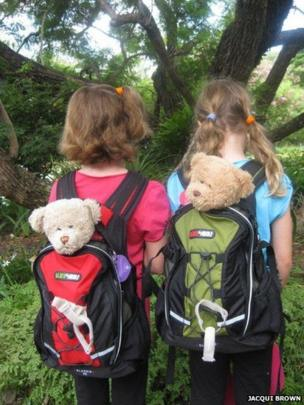 Teddy bears in backpacks