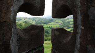 A view through the arrow slits at Carreg Cennen Castle