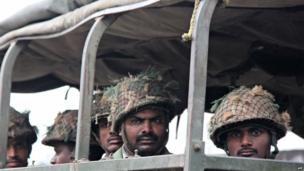 Indian soldiers look on from a military vehicle during a patrol following communal riots between Muslims and Hindus in Muzaffarnagar, India's Uttar Pradesh state, on September 9, 2013.