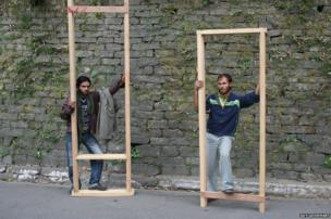 Two men with wooden frames