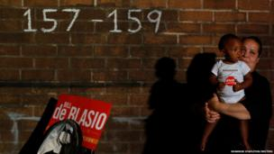 A young boy and his aunt wait for Democratic candidate for New York City mayor Bill de Blasio to arrive at a mayoral primary results party in New York