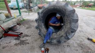 A mechanic repairs a puncture