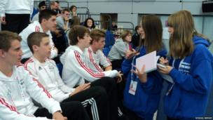 The young reporters interview volleyball players from their school who play for England Central