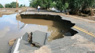Road with huge chunk missing from floodwater damage. Photo: Lynne Medvetz