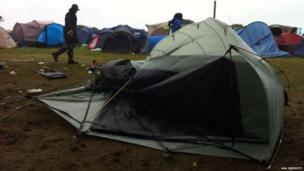Wind-blown tent in a music festival campsite. Photo: Aga Giedroyc