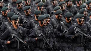 Mexican soldiers march during a military parade
