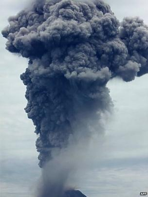 A giant column of ash clouds rise from the crater of the Mount Sinabung volcano during a fresh eruption on 17 September, 2013, as seen from Karo district.