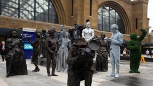 15 living statues greet commuters this morning to mark the opening of the newly redeveloped King's Cross Square in central London