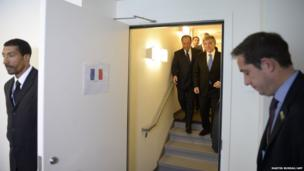 French President Francois Hollande (left in doorway) and Turkey's President Abdullah Gul