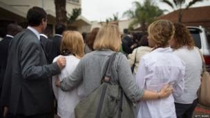 Foreigners take part in a funeral procession for Selima Merali, 41, and Selima's daughter Nuriana Merali, 15, who were killed in the attack by gunmen at the Westgate Shopping Centre in Nairobi, Kenya, on 25 September, 2013.
