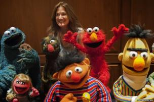 President of the Jim Henson Foundation, Cheryl Henson, with Muppets