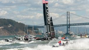 Fleet and spectator boats follow Oracle Team USA as it celebrates its victory over Emirates Team New Zealand in the 34th America's Cup on September 25, 2013, in San Francisco.