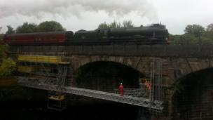 Ryder Cup train passes over a bridge