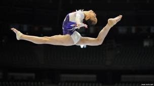 China's Yao Jinnan competes on the uneven bars