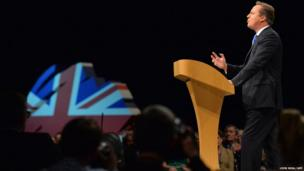 British Prime Minister David Cameron addresses delegates at the annual Conservative party conference in Manchester