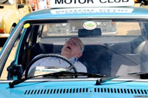 Man sleeping in car