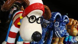 A Gromit with a stripy red and white outfit on.