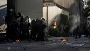 Riot police clash with protesters in Mexico City