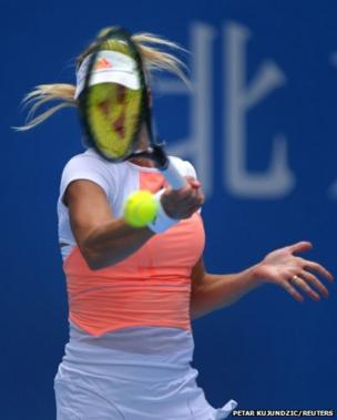 Maria Kirilenko of Russia returns the ball