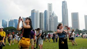 Crowds gather in Padang field during the Singapore Grand Prix weekend where a concert and other entertainments are held