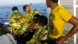 Grab from video released by the Guardia Costiera shows immigrants on a Guardia Costiera boat after their rescue near Lampedusa (3 October 2013)