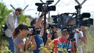 Broadcast crews outside Lampedusa airport on 4 October 2013