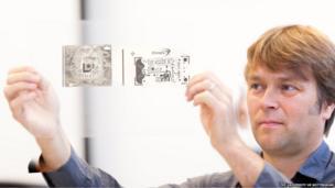 Professor Richard Haugh looks at a circuitry plan