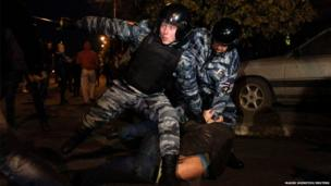 Russian police detain a man following a protest in Moscow