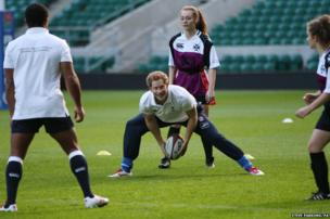 Prince Harry takes a coaching session for youngsters at Twickenham Stadium