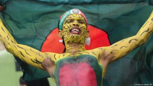 A Bangladeshi cricket fan cheers