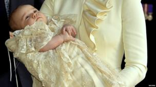 Prince George held by his mother