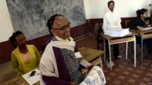 Woman at a polling station in Madagascar, 25 October 2013