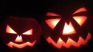 Two scary-looking carved pumpkins