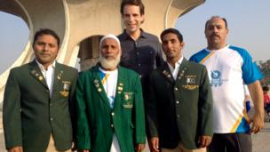 Abdul Ghafoor (centre left), Pakistan's first Commonwealth weightlifting medallist (in Edinburgh 1970) with his two sons, BBC Queen's Baton Relay presenter Mark Beaumont and Glasgow 2014 baton bearer.