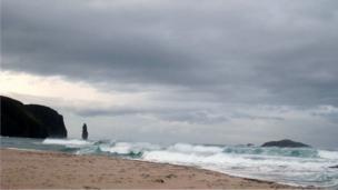 Waves crashing on Sandwood Bay